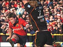 Ronan O'Gara lands an early drop-goal against the Dragons