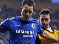 Chelsea goalscorer John Terry (left) holds off Wigan's David Connolly