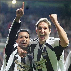 Newcastle's Nolberto Solano with team-mate Robbie Elliott