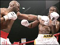Danny Williams (left) unleashes a blow at Audley Harrison