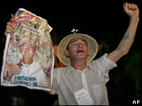 A member of the Landless Movement celebrates after Sister Dorothy Stang's killers are convicted