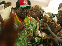 President Robert Mugabe walks among supporters at his party conference