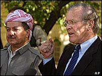 US Defence Secretary Donald Rumsfeld, right, with Kurdish Democratic Party leader Massoud Barzani in Salahedin, near Irbil, Iraq, 12 April 2005