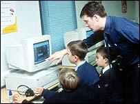Male teacher with three boy pupils