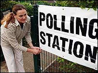Woman at polling station in Gloucestershire