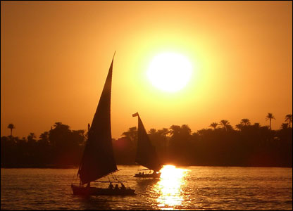 Sunset in Egypt with boats and palms