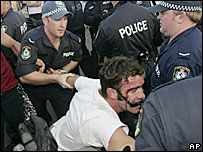 A man is arrested at Cronulla Beach in Sydney, 11/12/05