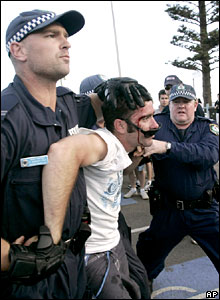 Police arrest a man on Cronulla Beach, Sydney