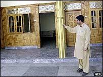 Householder points to house in Mardan