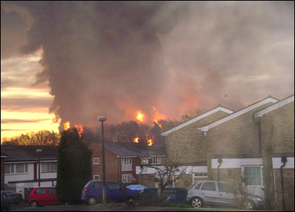 Smoke rising over houses