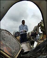 Man looking at wreckage in Nigeria