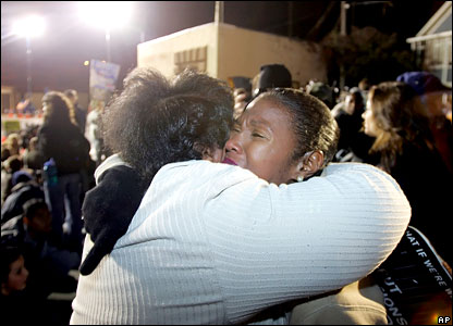 Campaigners against the death penalty hug outside San Quentin prison
