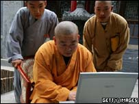 Monks using laptop, Getty Images