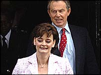 Tony and Cherie Blair leaving Downing Street for an audience with the Queen