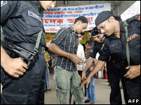 RAB soldiers frisk a passenger at a ferry terminal in Dhaka