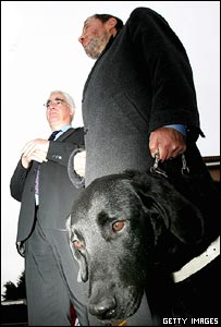 Alistair Darling, David Blunkett and guide dog