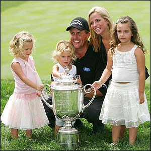 Phil Mickelson poses with his wife and children after victory in the USPGA