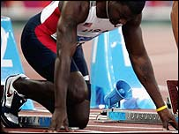 Justin Gatlin in the blocks ahead of last year's Olympic 100m final in Athens
