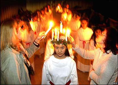 School children at the Johannes School in Stockholm enact Lucia Queen of Lights and her maidens