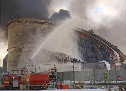 Firefighters continue to extinguish the flames after a massive blaze at Buncefield oil depot in Hemel Hempstead, Hertfordshire, England