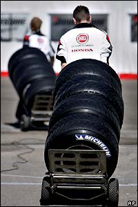 BAR mechanics take the tyres to be packed away