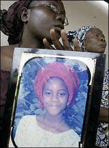 A relative holds up a picture of her younger sister who was on the Sosoliso Airlines plane that crashed in Port Harcourt, Nigeria