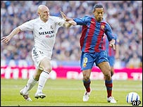 Barcelona's Ronaldinho tussles with Real Madrid's Thomas Graveson
