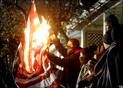 Anti-death penalty campaigners burn an American flag