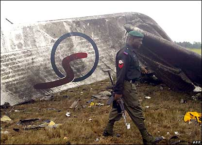 Policeman walks past Sosoliso Airlines plane wreckage in Port Harcourt, Nigeria