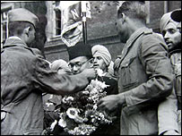 Subhash Chandra Bose is garlanded by members of the Free India Legion