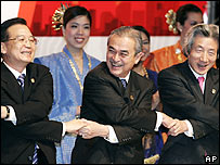 Malaysia's Prime Minister Adbullah Ahmad Badawi, centre, holds hands with Japanese Prime Minister Junichiro Koizumi, right, and Chinese Prime Minister Wen Jiabao,  Monday, Dec. 12, 2005.