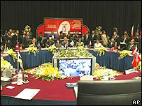 Asean leaders sit round the table at the plenary session of the 11th ASEAN summit in Kuala Lumpur, 12 December 2005