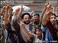 Shia Muslims chant in Sadr City, Baghdad