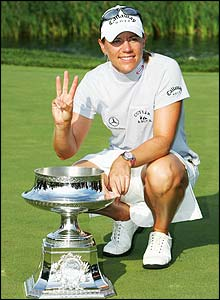 Annika Sorenstam celebrates with the trophy
