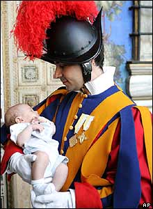 Swiss guard holding baby