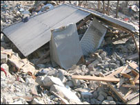 The debris of Naqsha's house in Kamsar camp