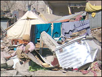 Collapsed shelters at Kamsar camp, where Naqsha lived