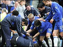 Chelsea's players mob goalscorer Claude Makelele