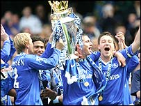 Frank Lampard and John Terry (right) hold the Premiership trophy aloft