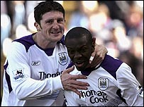 Manchester City's Shaun Wright-Phillips (right) celebrates his wonder goal with Jon Macken