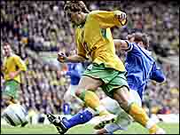 Darren Huckerby is brought down by Kenny Cunningham