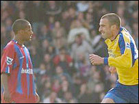 Palace's Wayne Routledge looks on as Danny Higginbotham celebrates