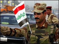 "Iraqi soldier with flag saying ""Elect Iraq"""