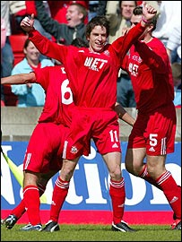 Marc McCann celebrates after scoring for Portadown in the Irish Cup final