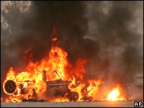 A Greek military vehicle burns following a suicide attack in Kabul