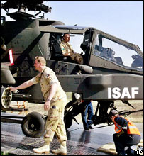 Dutch soldiers unload an Apache-D helicopter from a cargo aircraft in Kabul