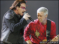 U2 singer Bono (L) and bassist Adam Clayton perform at the MGM Grand Garden Arena in Las Vegas