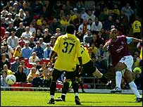 Anton Ferdinand (l) scores for West Ham against Watford