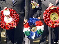 Veterans hold wreaths during the Cenotaph service