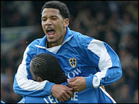 Jobi McAnuff celebrates with team-mate Cameron Jerome